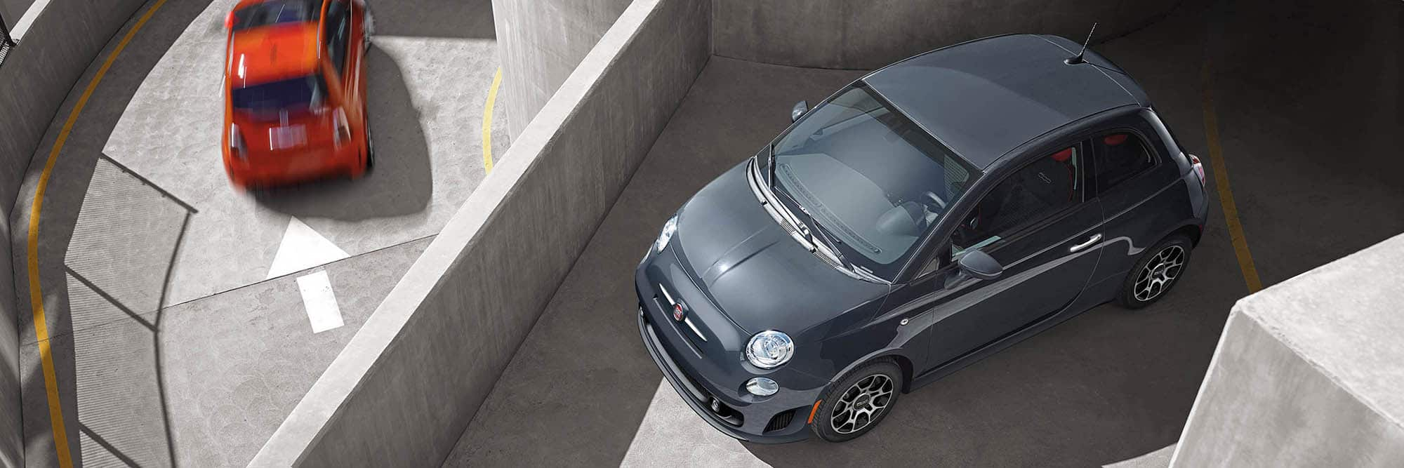 Overhead view of a 2019 Fiat 500 Pop parked on the roof of a parking structure.