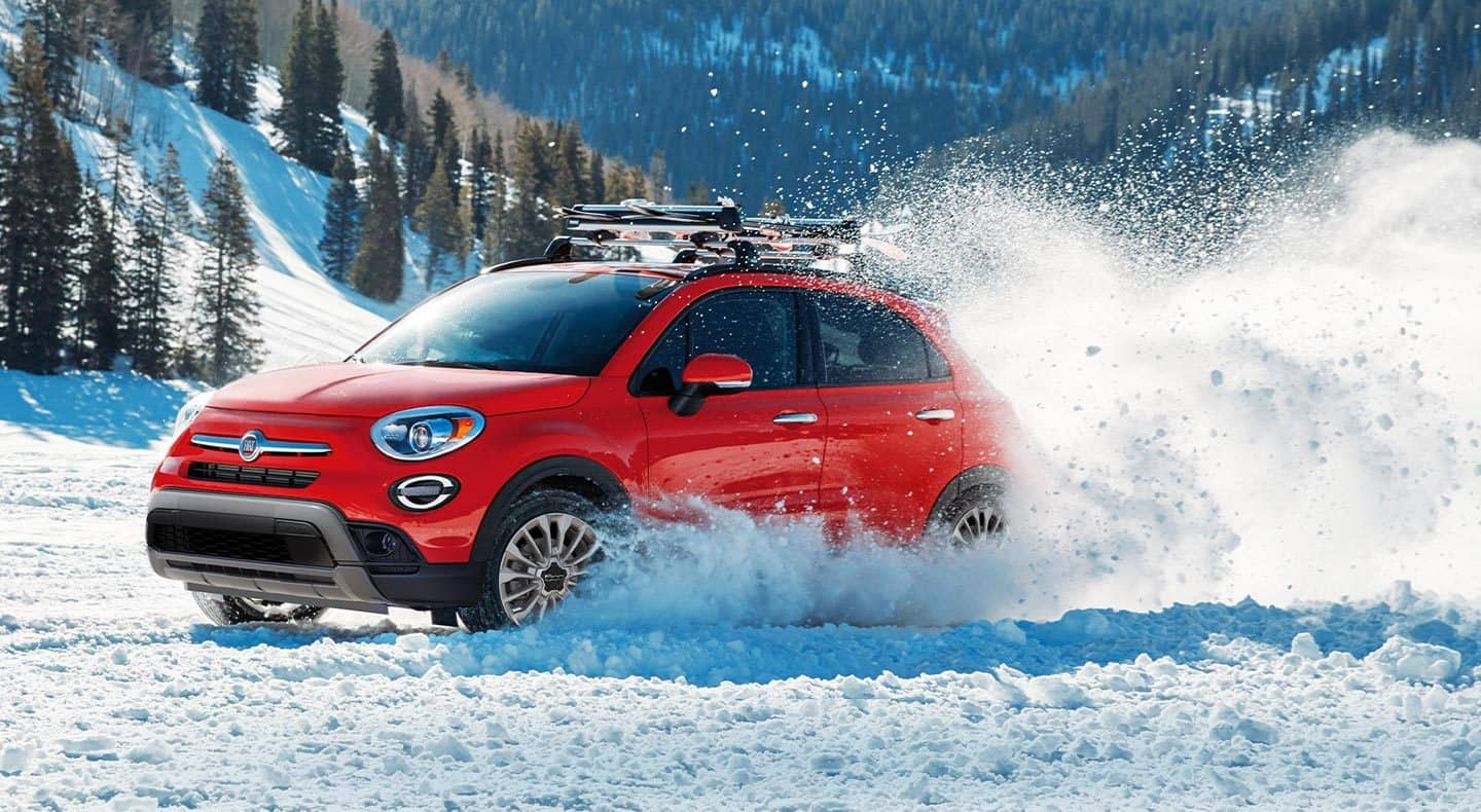 Display Standard All-Wheel Drive helps provide excellent traction and responsive performance during nearly all weather conditions. 2019 Fiat 500X Trekking model shown in Arancio (Orange).