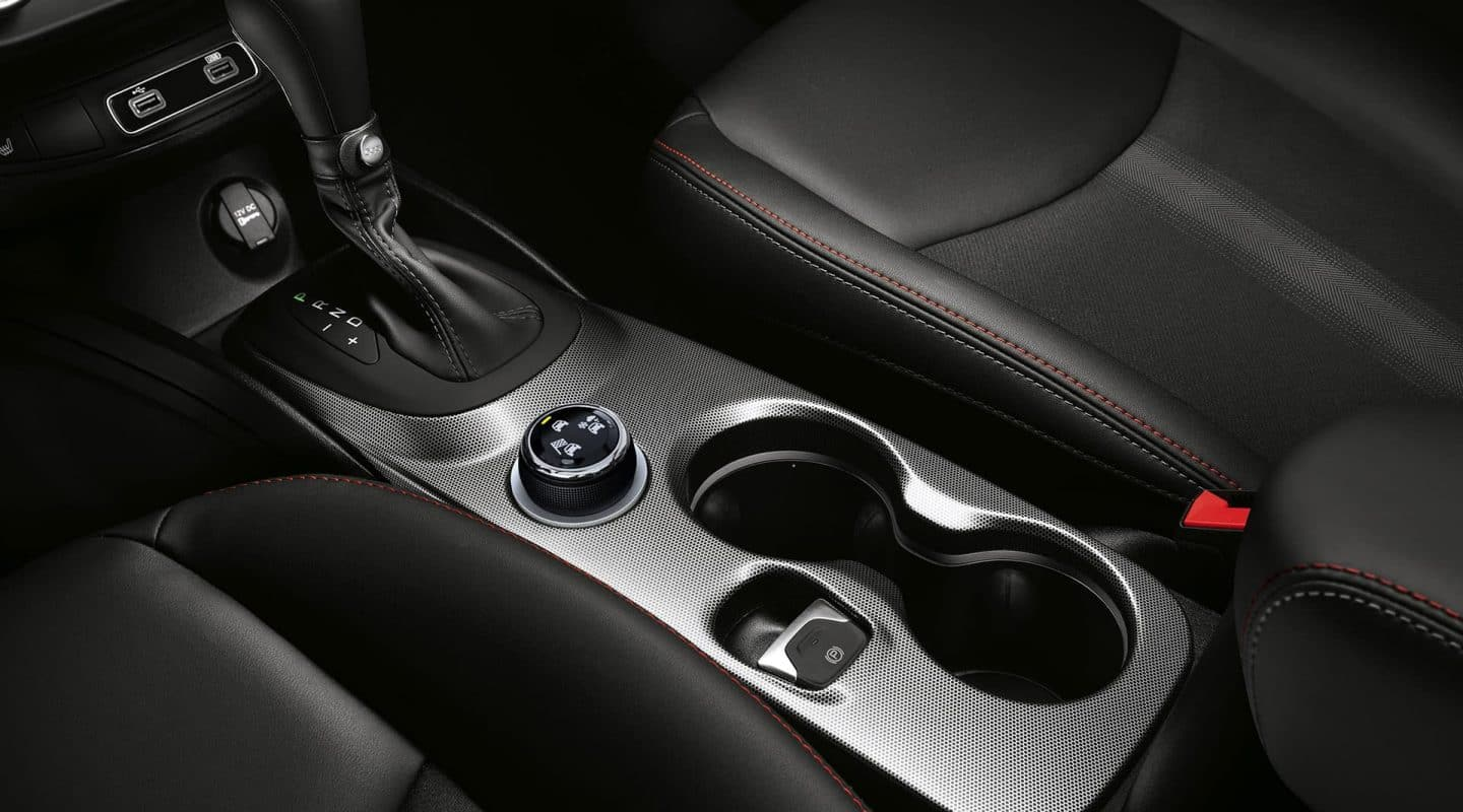 Display  Close-up of the center console and cup holders in the 2020 Fiat 500X.
