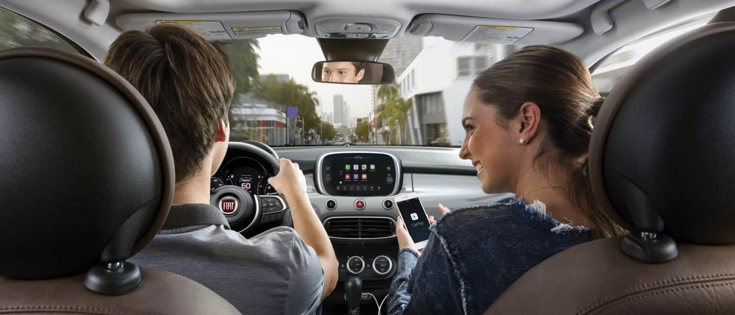 A couple in the front seat of the 2020 Fiat 500X presented from the rear seat.